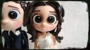 cropped-weddingtoppersgoldnavysuitlady.jpg